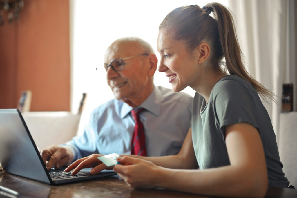 Grandfather and granddaughter working online together 4 steps to 10K per month online